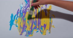 Child Painting Rainbow Color Paint on White Paper 422 10bit, 4K Stock Footage