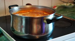 Boiling soup on kitchen stove Stock Footage