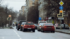 Cars Are at a Traffic Light. People Crossing the Road. Traffic in the City. Stock Footage