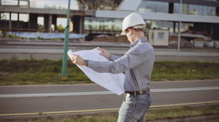 Architect on construciton site check project Stock Footage