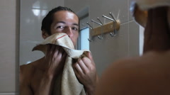 man smiling in front of a mirror in the bathroom - stock footage