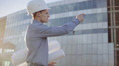 Angry architect with helmet is shouting Stock Footage