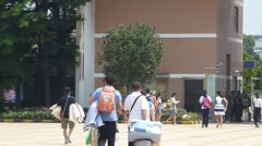 Shenzhen, China: high school holidays, students carry luggage home Stock Footage