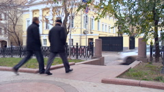Exit From the Boulevard. Two Men Are to Move Pedestrian Across the Road. Cars Stock Footage