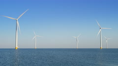 Wind turbines with rotating blades in an offshore wind park Stock Footage