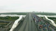A lot of people run a marathon on the bridge Stock Footage