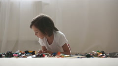 Cute little preschool children, boy brothers, playing at home with constructo Stock Footage
