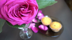 Little cakes and rose on wooden table on Valentine's Day. Love the concept of - stock footage