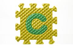 Rubber puzzle with letter c Stock Photos