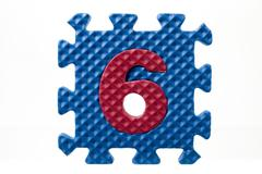 Rubber puzzle with number six Stock Photos