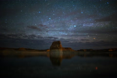 5K Astro Time Lapse of Stars over Lone Rock at Lake Powell, Utah  Stock Footage