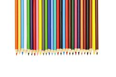 View of color pencils arranged in a row Stock Photos
