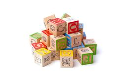 Wooden playing cubes arranged on top of each other Stock Photos