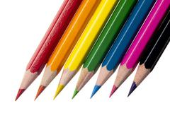 Color crayons arranged on white background Stock Photos