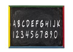 Alphabet letters and numbers written on slate board Stock Photos