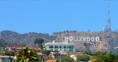 Hollywood sign and palm trees in Los Angeles, California 4K RAW Stock Footage