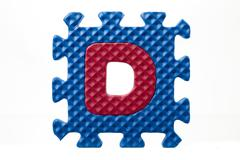 Colorful rubber puzzle with letter d Stock Photos