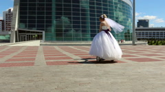 Bride and groom ride on Segway Stock Footage