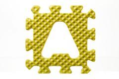 Foam alphabet puzzle on letter a Stock Photos