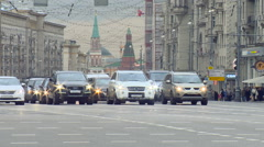 Cars go on the Road on the Streets of Moscow in the Background the Towers of Stock Footage