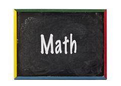 Math written on small students slate board Stock Photos