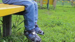 Legs a little boy baby swing Stock Footage