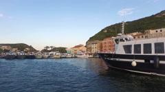 Bonifacio harbor in Corsica, boat point of view Stock Footage