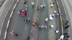 Young people run a marathon on the big bridge Stock Footage