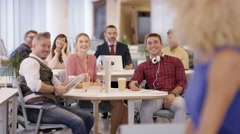 4K Portrait of smiling businesswoman in office with staff working in background Stock Footage