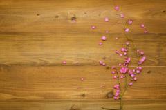 Pink flowers on wooden Kuvituskuvat