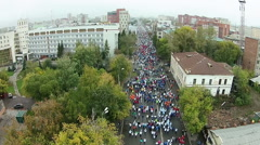 Many young people run a marathon through the main streets - stock footage