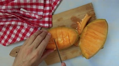 Man slicing and eating tasty cantaloupe melon, top view Stock Footage
