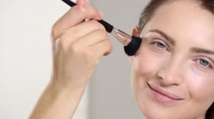Young beautiful perfect model applying professional makeup Stock Footage