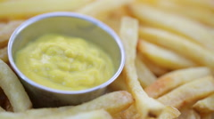 French Fry in Mustard Stock Footage