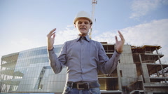 Angry crazy architect with white helmet is very shouting and crying Stock Footage