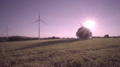 Wind generator farm at sunset Arkistovideo