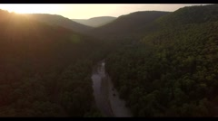 Aerial view of a sunset , flying over the green canyon , lens flare 4k Stock Footage