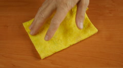 Wipe the table a damp cloth. - stock footage