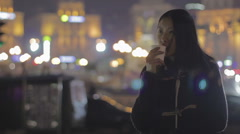 Asian girl drinking tea and relaxing after hard workday, thinking about life Stock Footage