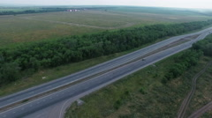 Aerial footage of road and transport, people traveling by cars on a freeway Stock Footage