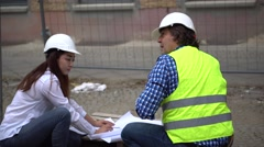 Teamwork on construction site - stock footage