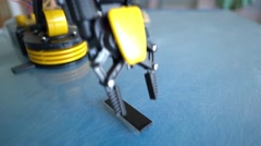 Model of robot arm. Robot building toy house Stock Footage