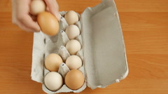 Eggs in the box on the table. Stock Footage
