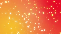 Sparkly light particles moving across a yellow orange red gradient background - stock footage