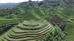 CINEMATIC AERIAL SEQUENCE FLY OVER + REVERSE TILT OF LONGJI RICE TERRACES CHINA Stock Footage