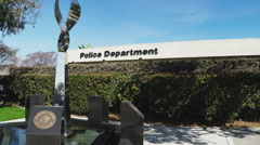 Generic Police Department Sign On Building With Sculpture Stock Footage