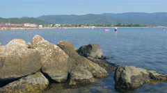 Panoramic view of sea bay with lot of tourist in the water and beach by Sheyno. Stock Footage