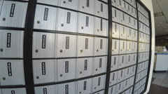Pan Shot Of A Wall Of Post Office Lock Boxes - Downey CA Stock Footage