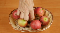 Maggoty apples in a basket. Stock Footage
