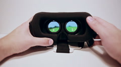 Vr-helmet for the smartphone, miniature mans hands wear them Stock Footage